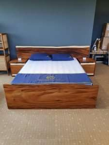 Suar wood bed by Collectif Designs