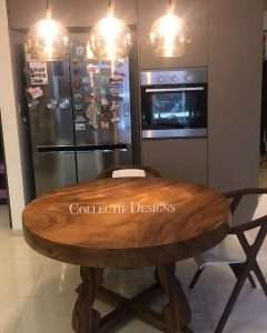 Suar wood round table by Collectif Designs delivered to client in Singapore