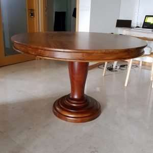Teak wood round table by Collectif Designs delivered to client in Singapore