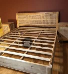Teak wood rattan bed by Collectif Designs delivered to client in Singapore
